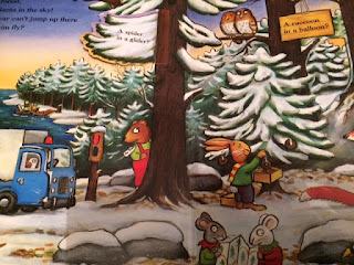 Inside the book, showing a bear in a snowy forest, along with other characters