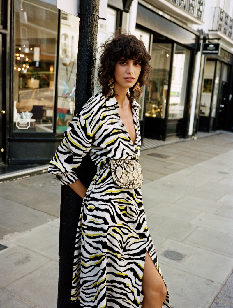 Mica Arganaraz models Zara Zebra Printed Dress and Animal Print Belt Bag
