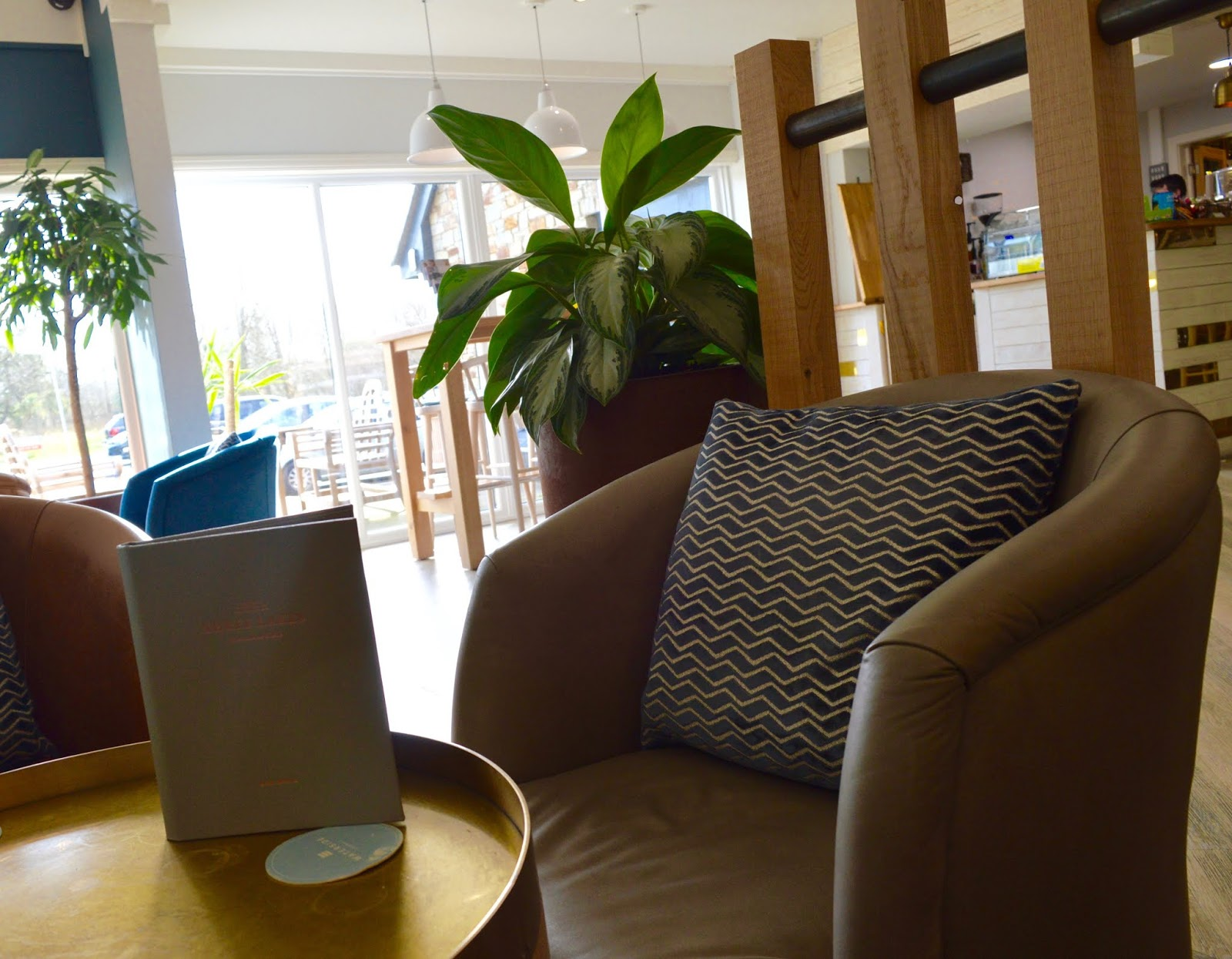 Waterside Cornwall Review | Self-Catering Lodges Near The Eden Project - lounge area / cafe