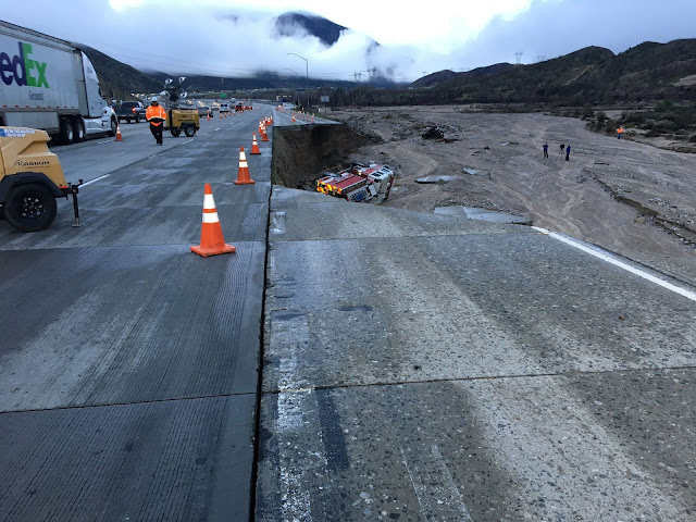 SB I-15 is washed away; fire engine tumbles off the side