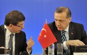 Ahmet Davutoglu (L) with Recep Erdogan (R)