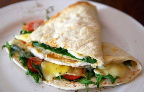 Cheesy stuffed flat bread with herbs