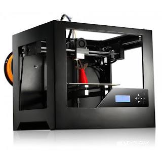 imprimante 3D réalisant un objet avec une bobine orange