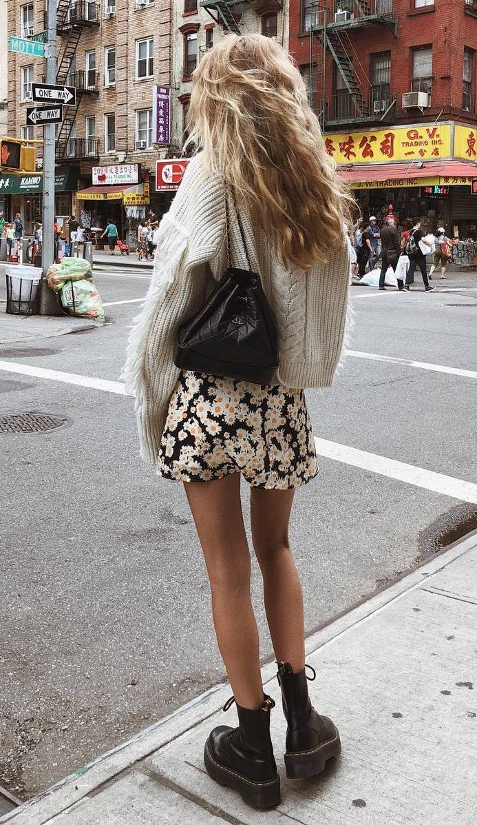 cozy fall outfit idea / knit sweater + floral skir + backpack + boots