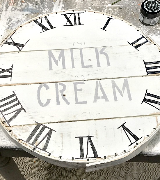 stenciling a milk and cream stencil on a cheese box