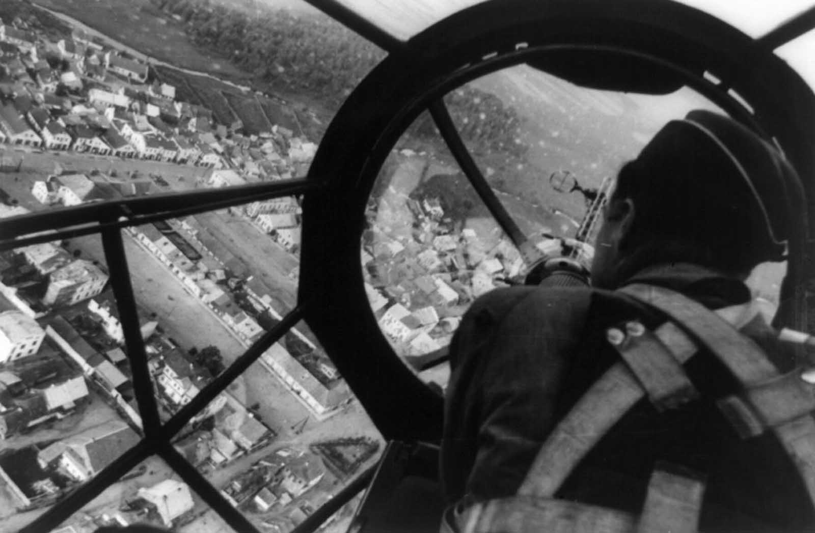 View of an undamaged Polish city from the cockpit of a German medium bomber aircraft, likely a Heinkel He 111 P, in 1939.
