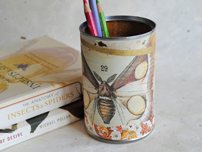 papered pencil cup with moth