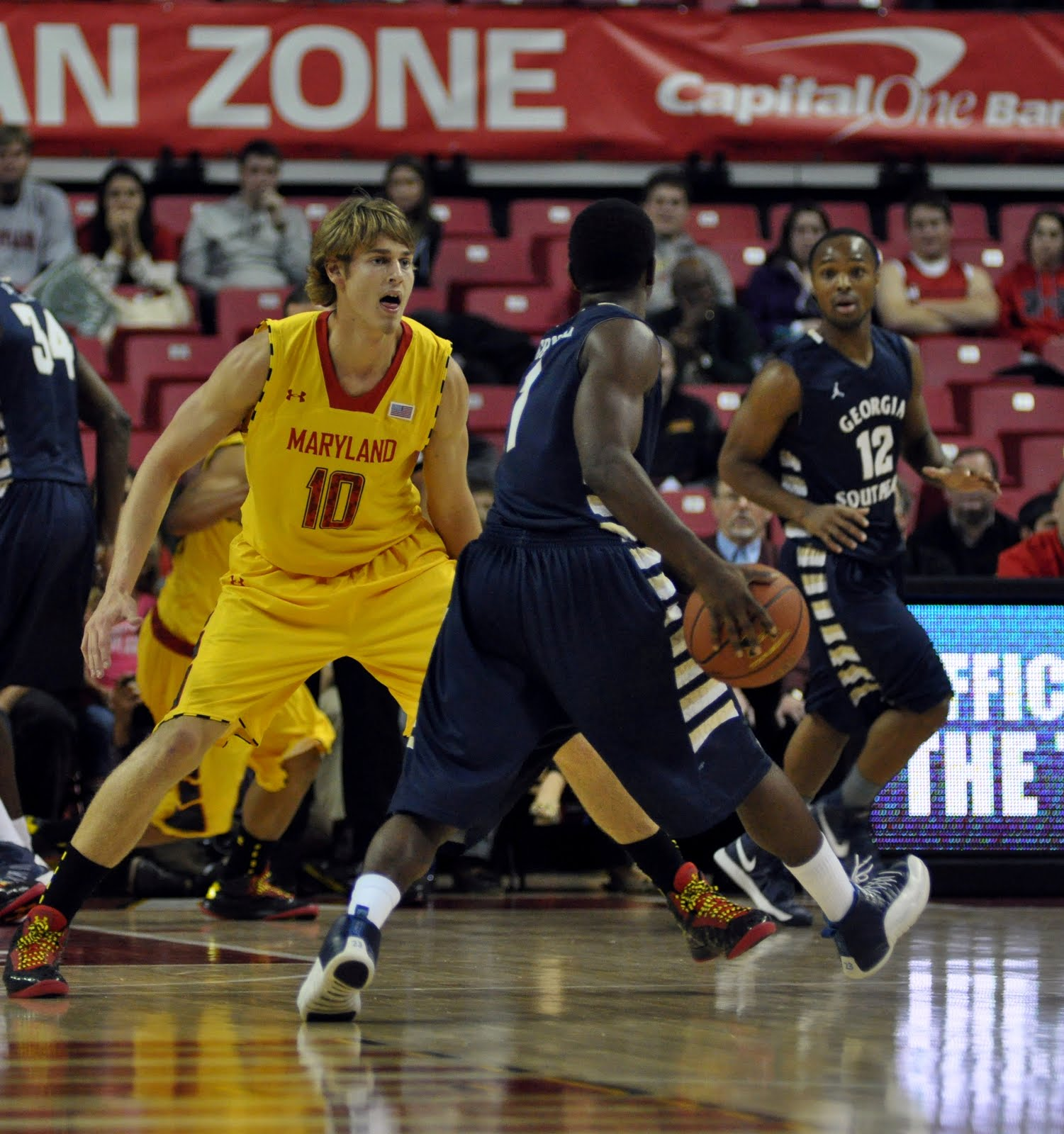 Maryland head coach Mark Turgeon forced freshman guard Jake Layman to cut off his awesome long hair.