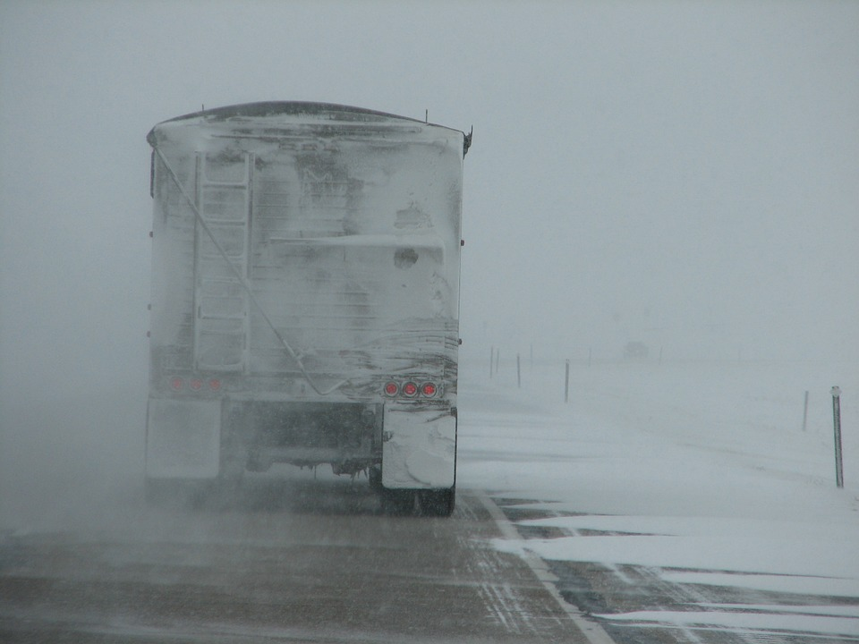 truck in snowstorm.jpeg