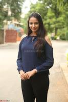 Poojita Super Cute Smile in Blue Top black Trousers at Darsakudu press meet ~ Celebrities Galleries 024.JPG