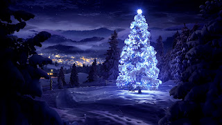 Real-Christmas-tree-decorated-glowing-in-snow-star-at-top-image.jpg