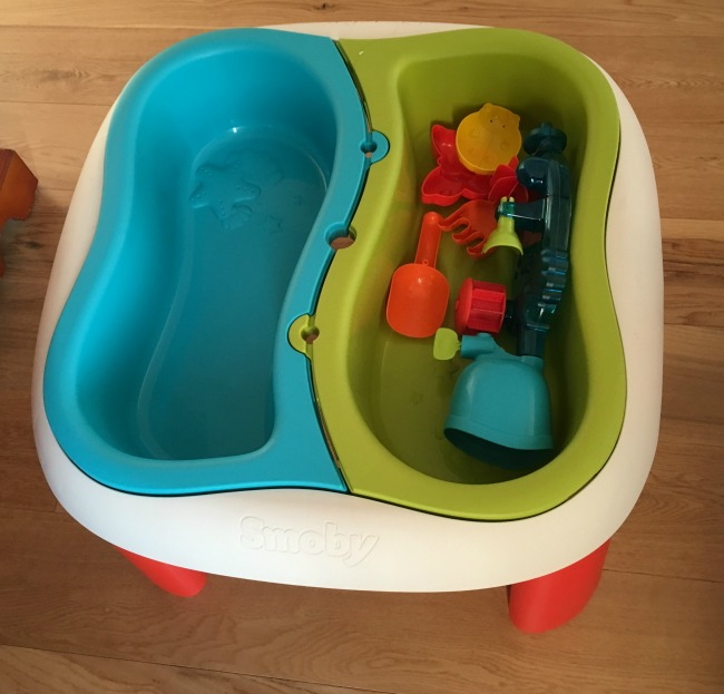The Smoby Water and Sand Table two compartments and some accessories