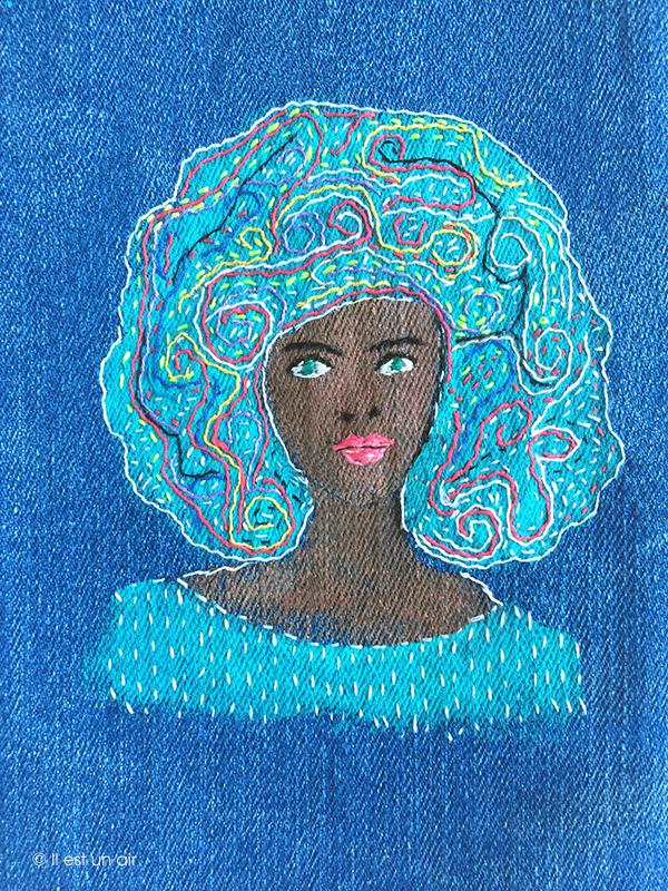 Femme brodée sur du jean
