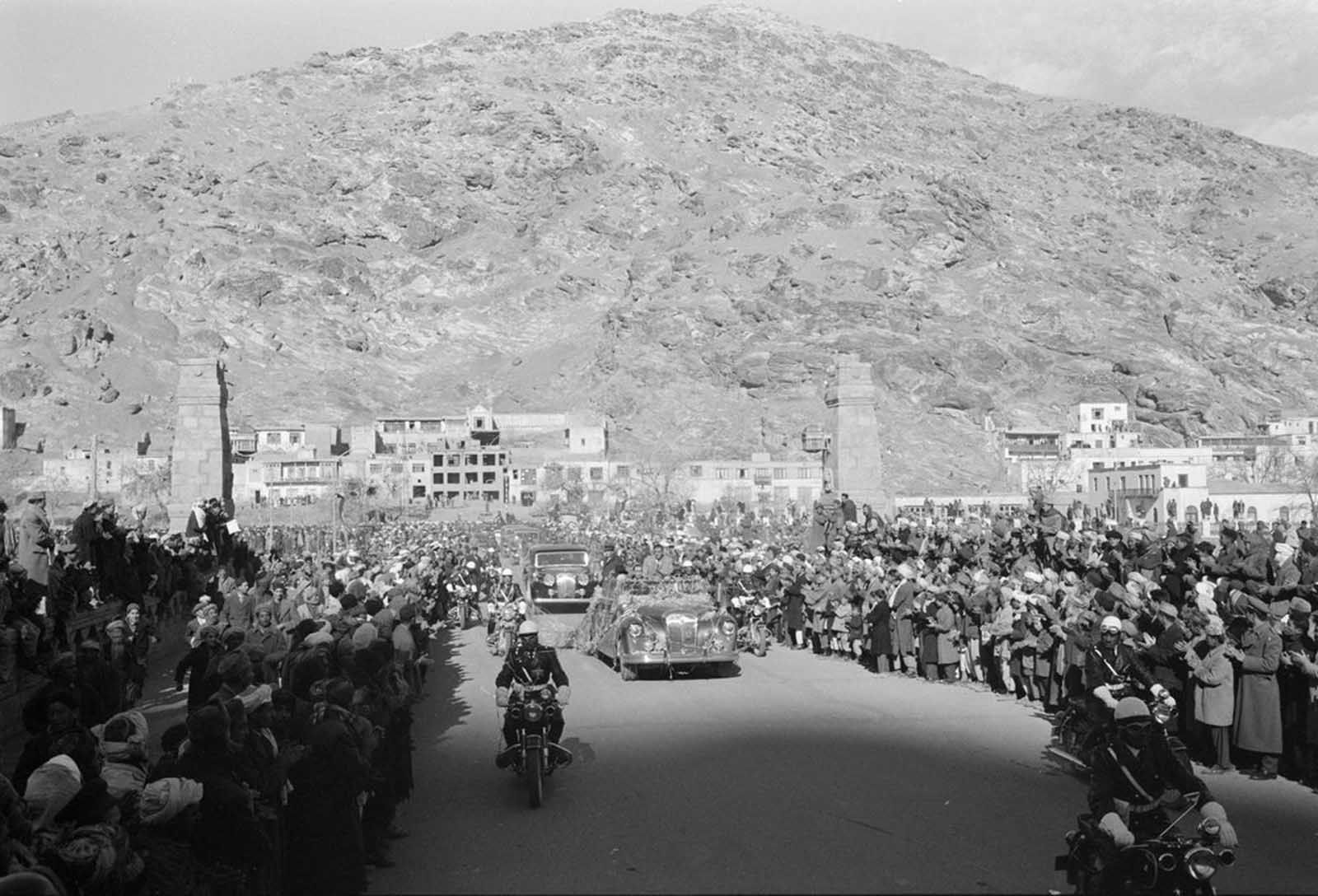 Motorcade for President Eisenhower's visit to Kabul, Afghanistan, on December 9, 1959. Eisenhower met briefly with the 45-year-old Afghan king, Mohammad Zahir Shah, to discuss Soviet influence in the region and increased U.S. aid to Afghanistan.