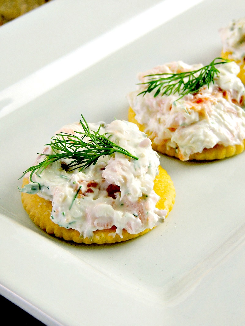 Smoked Salmon Bites - Creamy smoked salmon dip atop buttery RITZ Crackers. This is the perfect nibble for your family fun time! From www.bobbiskozykitchen.com