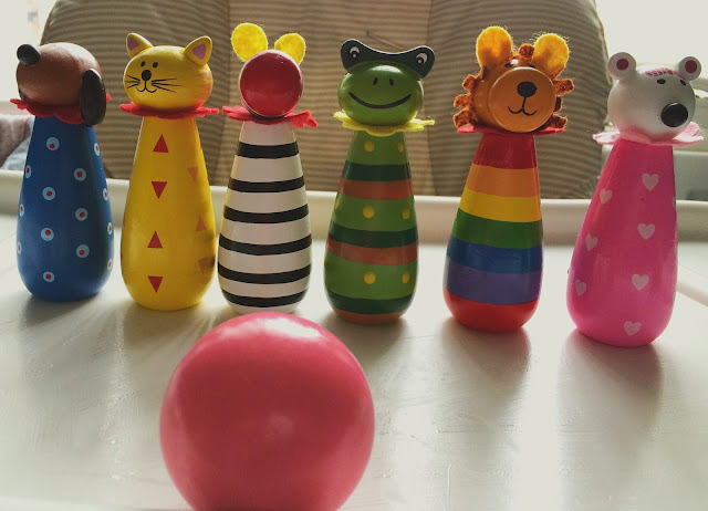 wooden animal skittles and pink ball