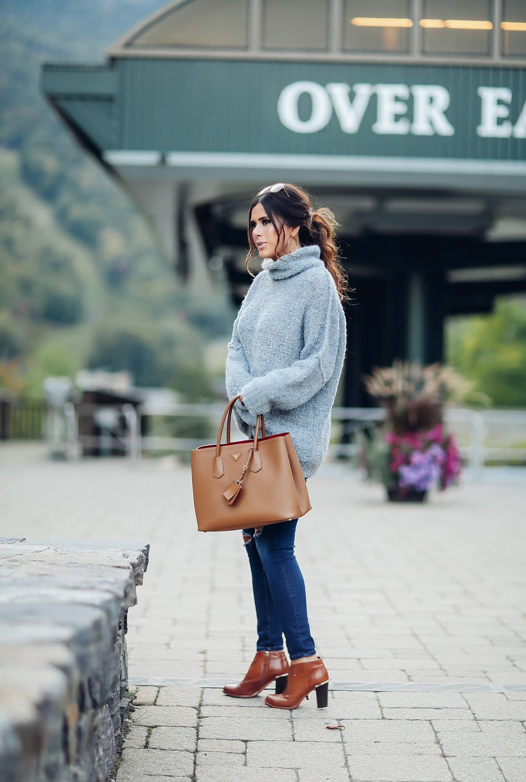 emily gemma, the sweetest thing blog, Free people turtleneck sweater, AG ripped skinny jeans, best AG skinny jeans, bloggers wearing AG skinny jeans, tan prada tote, tan cognac booties for fall, travel bloggers, travel and fashion blogger, Stowe mountain lodge, stowe vermont, pinterest fall fashion, pinterest fall outfits, fall fashion 2016, women outfits pinterest fall winter
