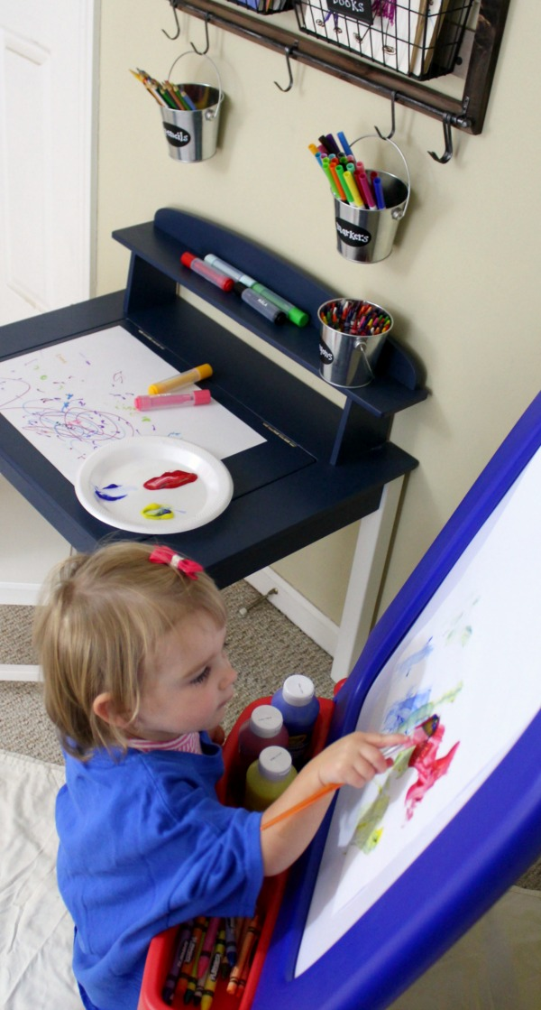 Organized art station for kid's art and craft supplies: Painting tips