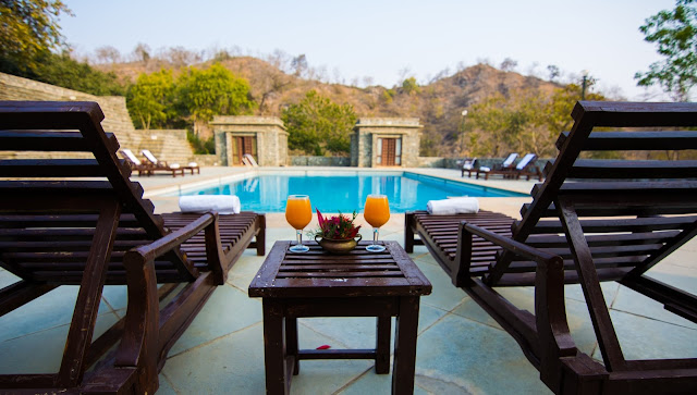 REJUVENATE THIS MONSOON IN THE LUSH GREENS AND THE WOODS AT V RESORTS