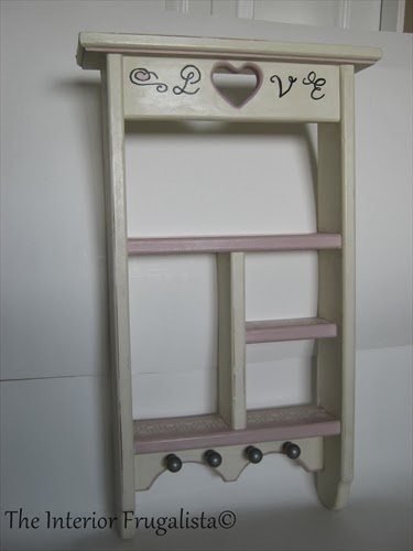 Vintage wooden wall shelf with IKEA knobs