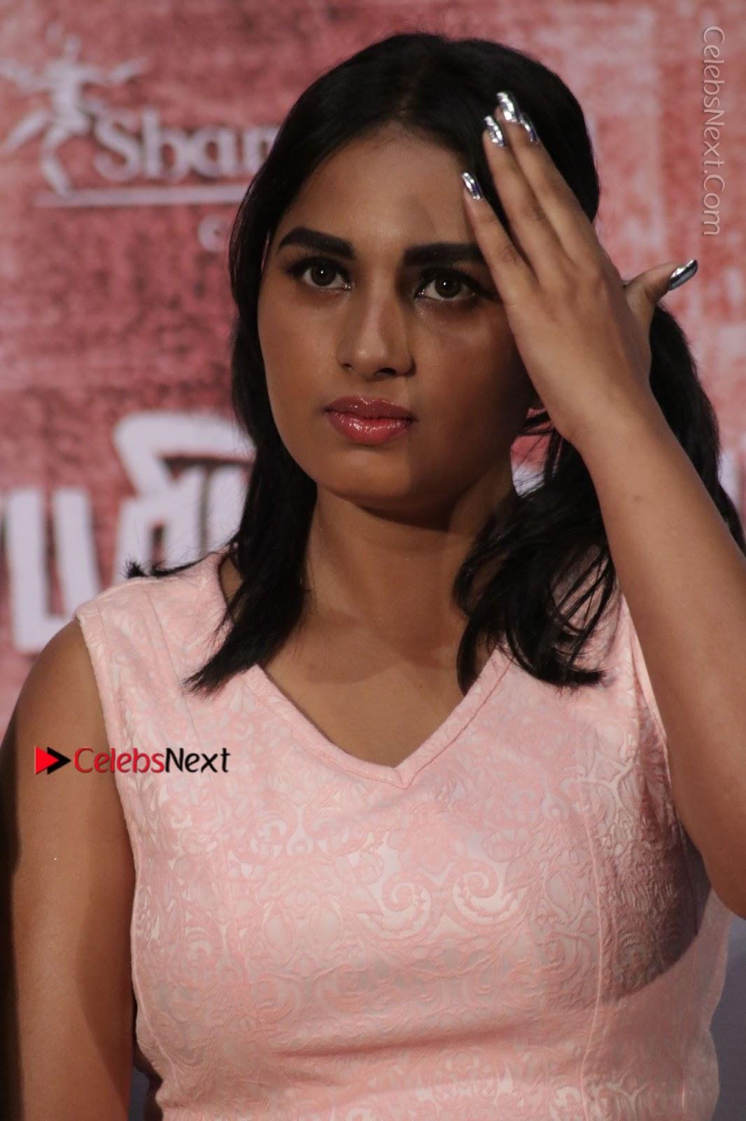 Srushti Dange Stills in Short Dress at Mupparimanam Press Meet