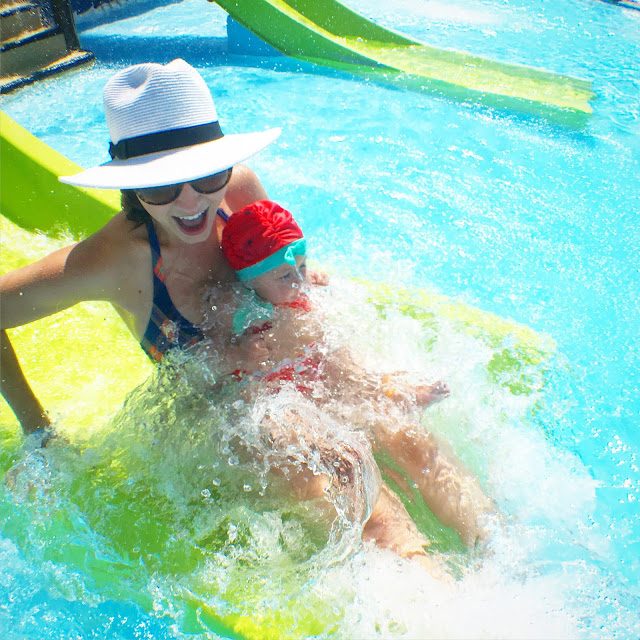 Amy West and daughter splash down on one of the kiddie slides at Shipwreck Island