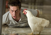 Stu wakes up to find a chicken in the suite in 'The Hangover' (2009)
