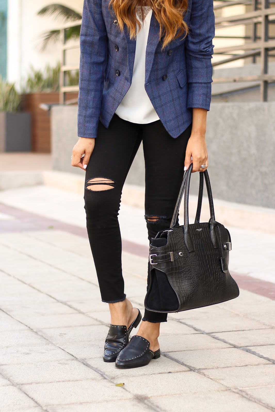 Black distressed jeans and studded shoes slides