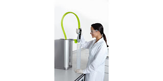 laboratory water purification equipment point of use station with technician drawing sample