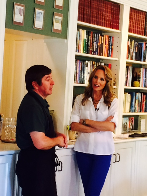 Owner Chris with TV personality chatting in A Butler's Manor living room