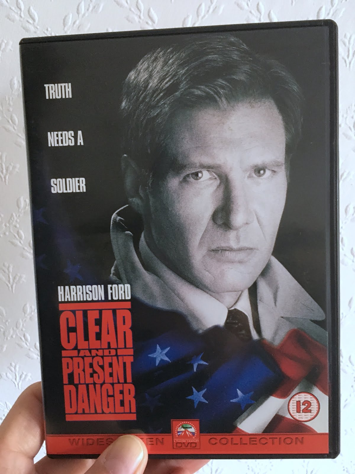 Man Watches Film Clear And Present Danger 1994