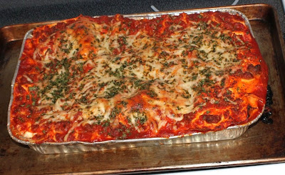 This is a photo of homemade lasagna and my mom's recipe. It is loaded with mozzarella cheese on top. The inside has ricotta cheese and a layer of crushed meatballs an sausage.
