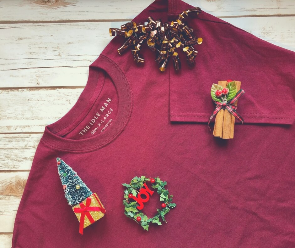 Burgundy t-shirt covered in Christmas decorations