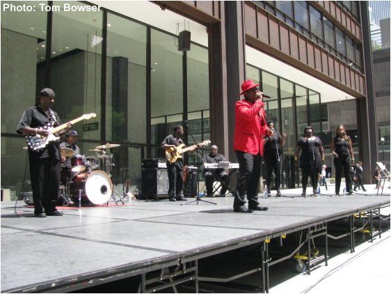 Theo Huff and his band playing for the 2016 Chicago Blues Festival Preview event at Chicago's Daley Plaza | Photograph by Tom Bowser