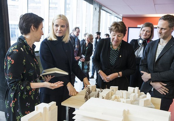 Crown Princess Mette-Marit of Norway visited the Oslo School of Architecture and Design. Princess Prada boots and Stella McCartney wool coat
