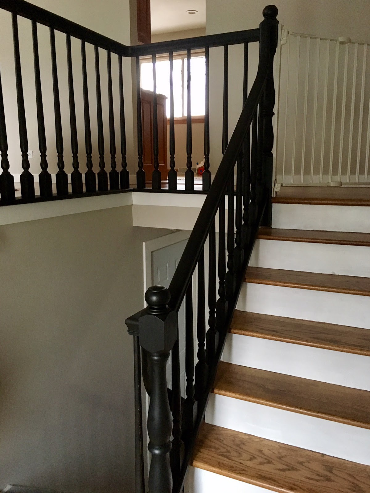 Russet Street Reno Paint Fixes Everything | Black Banister With White Spindles | Brazilian Cherry Stair | Victorian | Traditional Home | Iron Spindle White Catwalk Brown Railing | Gray