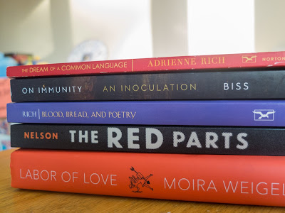 Book pile: On Immunity by Eula Biss, Blood, Bread and Poetry by Adrienne Rich, The Red Parts by Maggie Nelson, Labor of Love by Moira Weigel