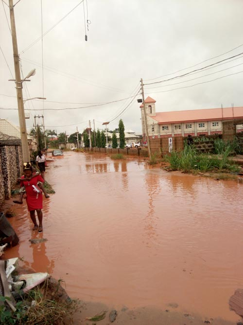 Church goers in Asaba forced to return home following bad road, flood in Delta State capital