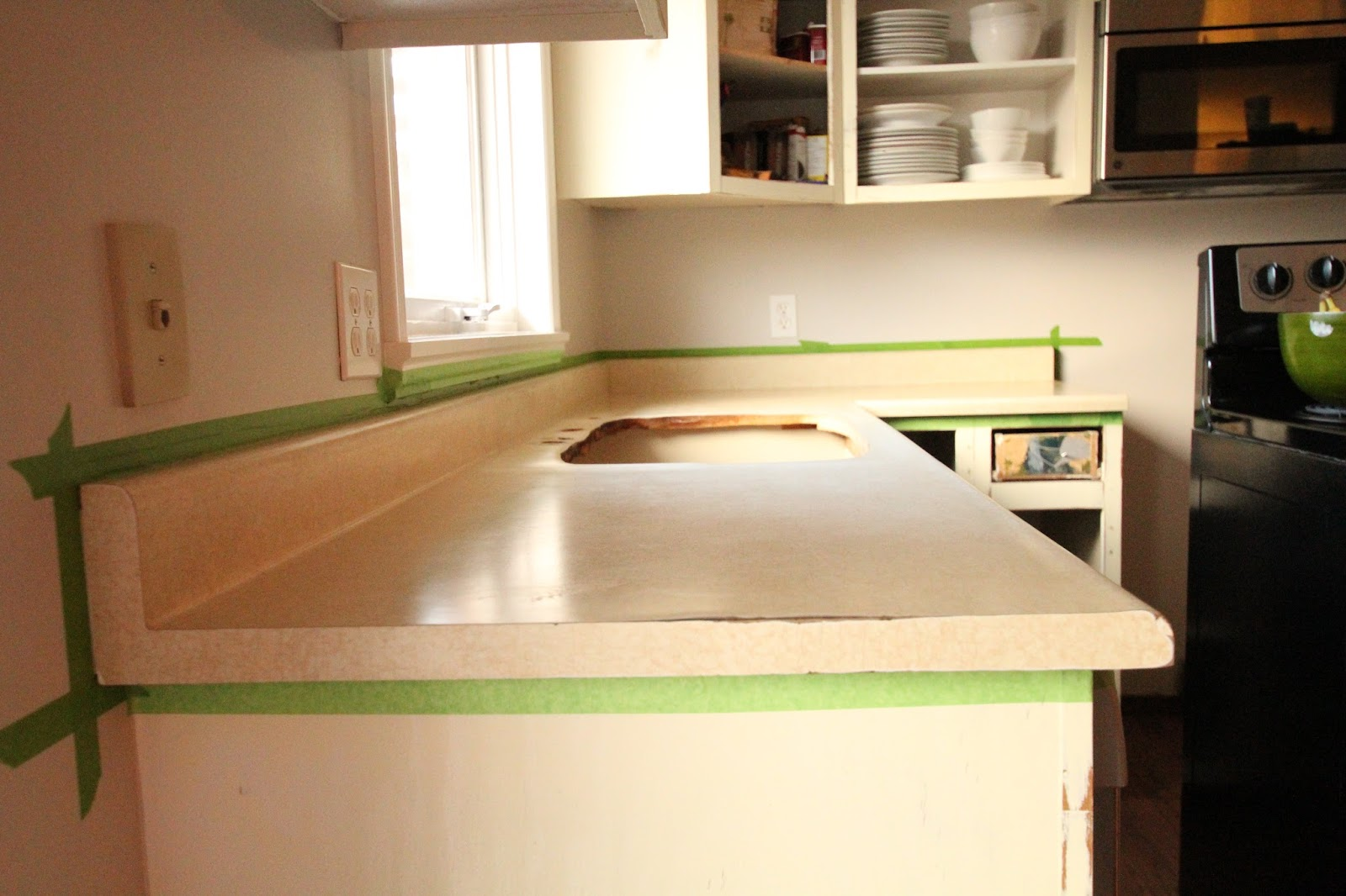 How to get beeswax off a counter top or table surface 5 steps - Use Painter S Tape To Mask Off All The Edges Of The Counter Tops Use Plastic Sheeting To Protect Cabinets And Appliances And Drop Cloths To Protect Your