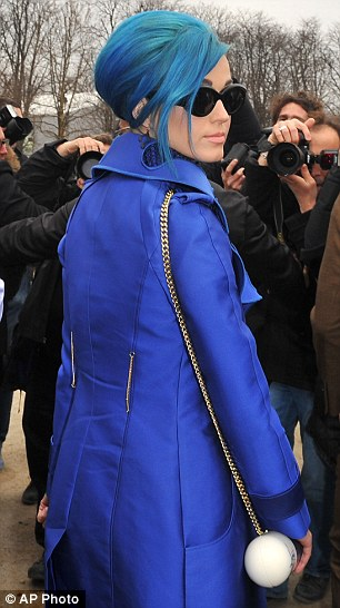 You're not playing Smurfette now! Katy Perry clashes her ...