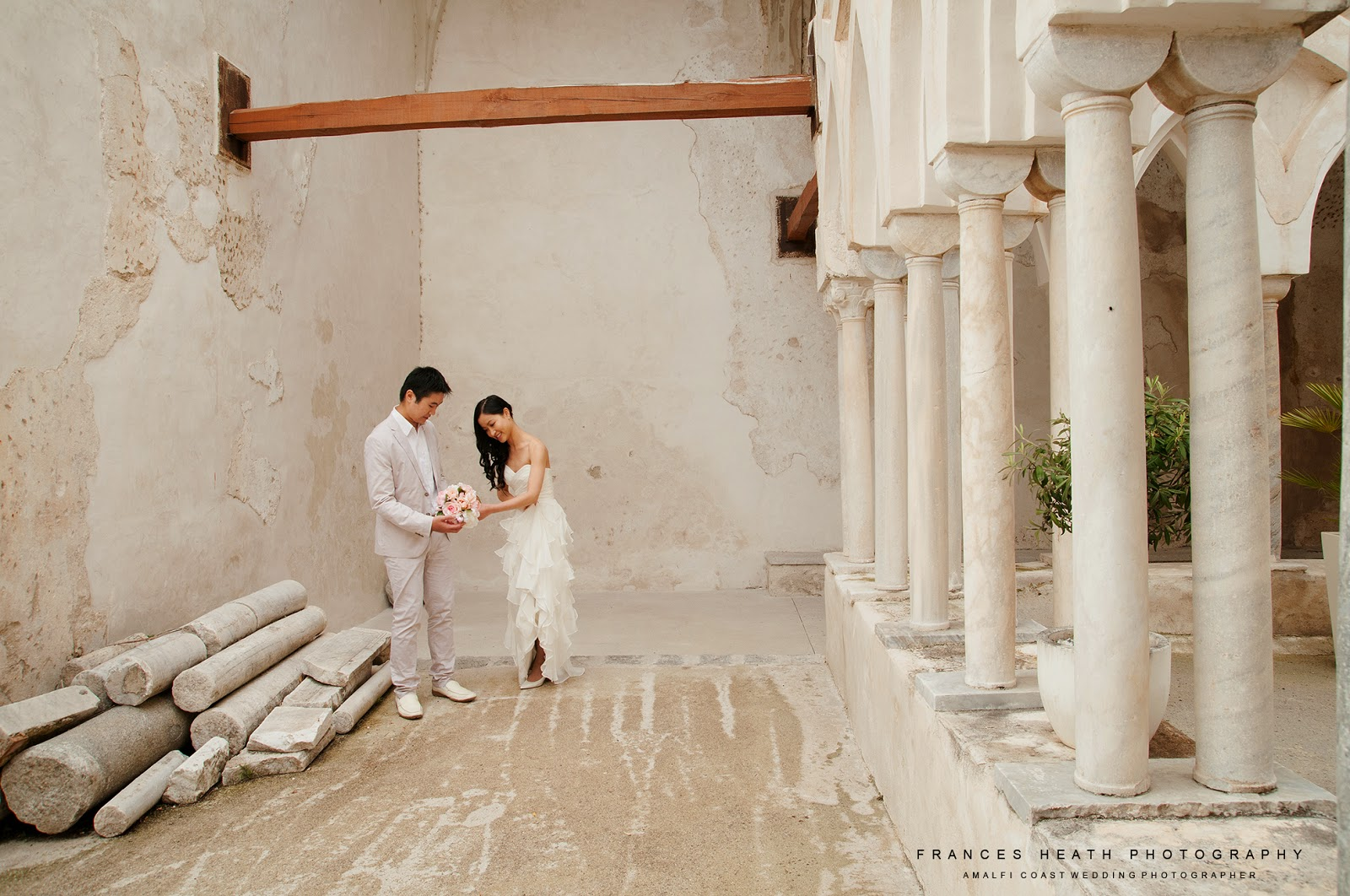 Wedding portrait in cloisters at Hotel Convento