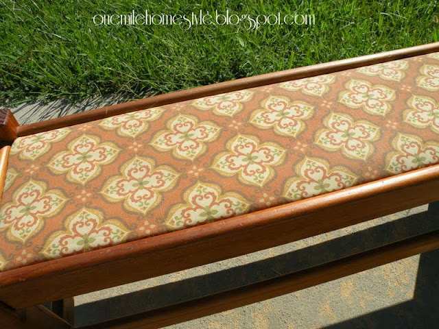 Bench with orange print fabric