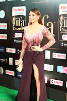 Hansika Motwani in Glittering Deep Neck Transparent Leg Split Purple Gown at IIFA Utsavam Awards 45.JPG