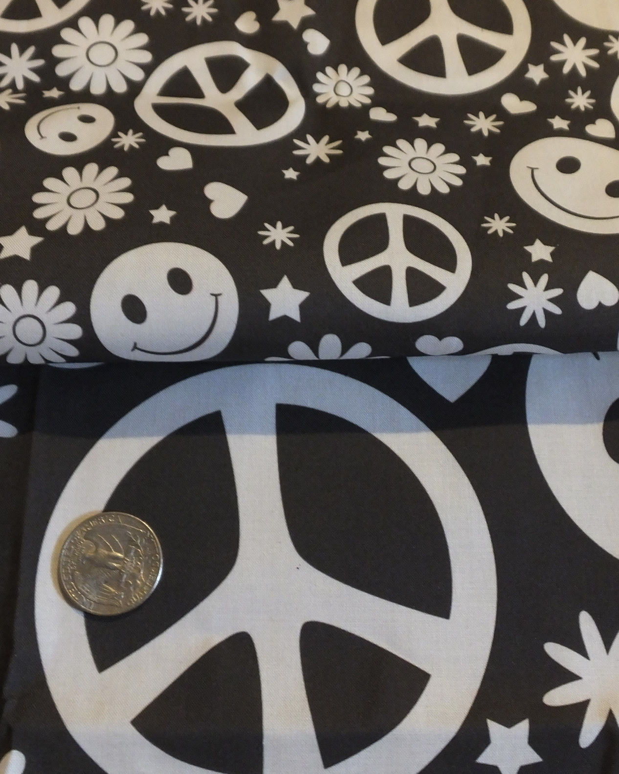 Hippie peace symbol and happy face black and white fabric