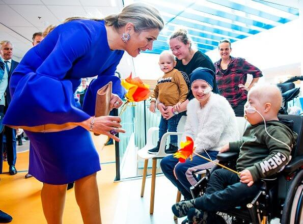 Queen Maxima wore a flowy bell sleeves deep-azure crepe dress by Roksanda. Princess Maxima Center for Pediatric Oncology