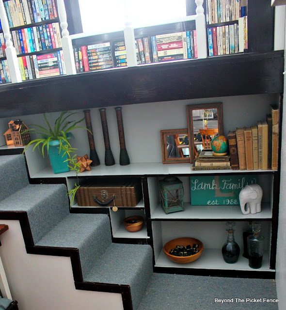 a built in bookshelf painted gray