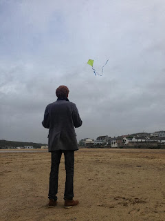 Flying a kite on the Cornish beach