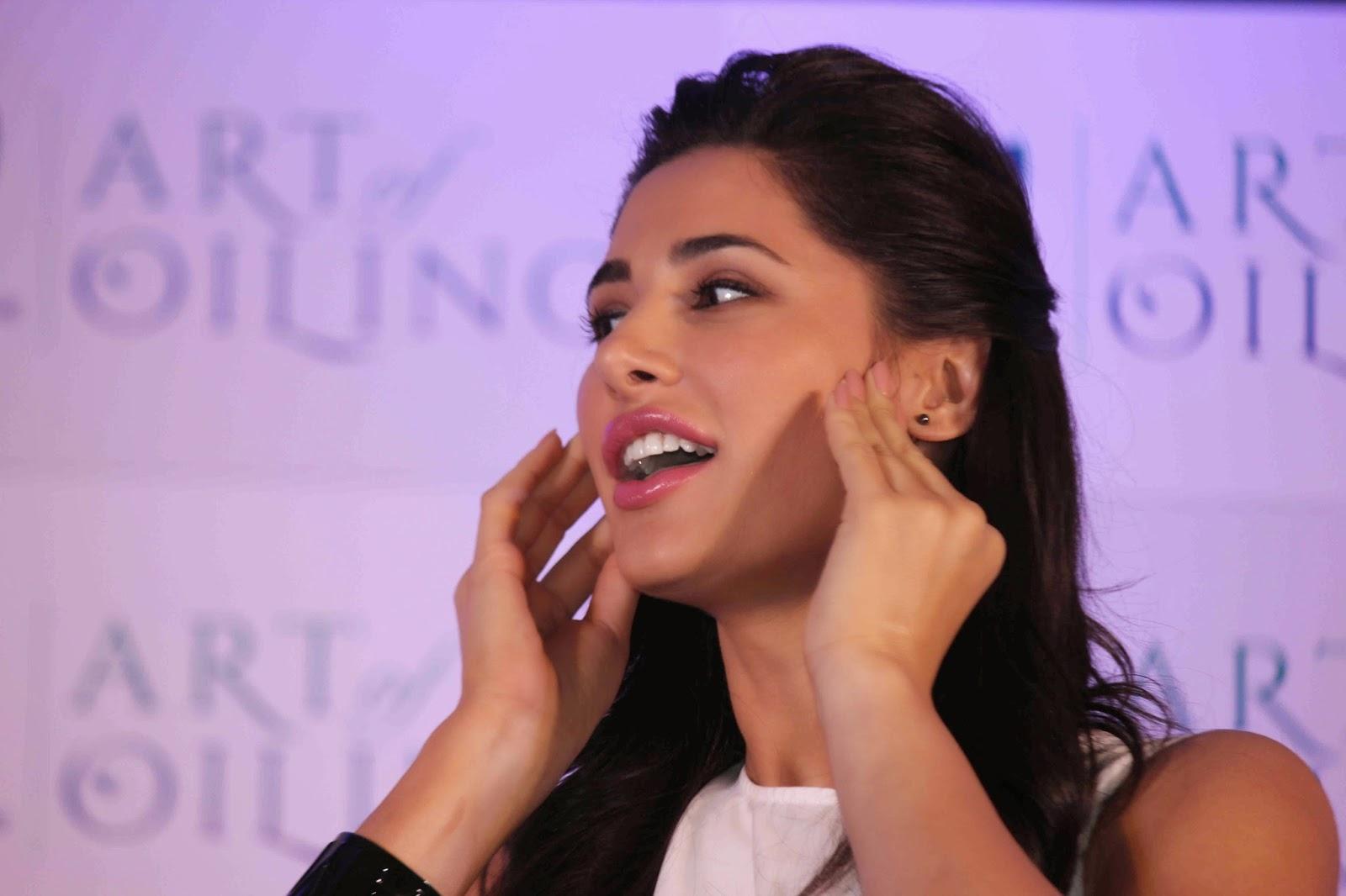 Glamorous Nargis Fakhri Hot Photos In White Dress