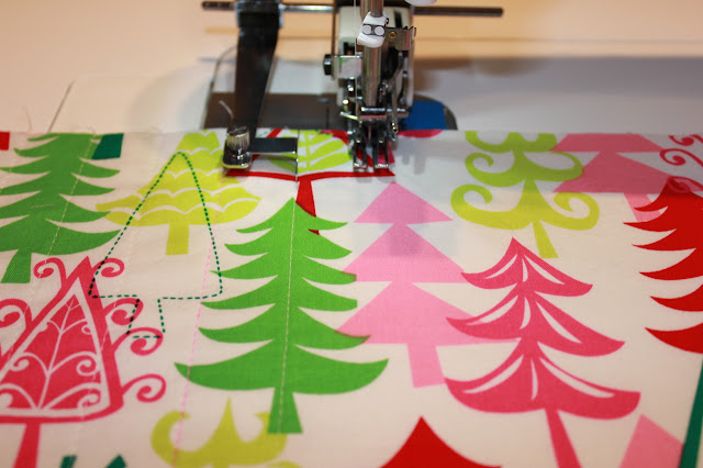 piece of holiday fabric with straight line quilting on machine