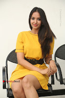 Actress Poojitha Stills in Yellow Short Dress at Darshakudu Movie Teaser Launch .COM 0201.JPG
